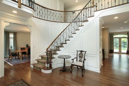 elegant staircase: Foyer with curved staircase in luxury home