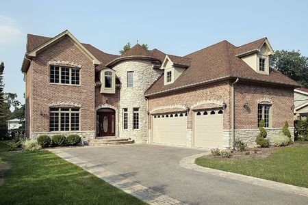 Brick new construction home with large turret photo