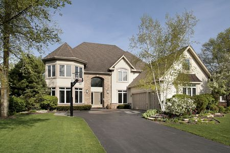 driveways: Front view of luxury home in spring