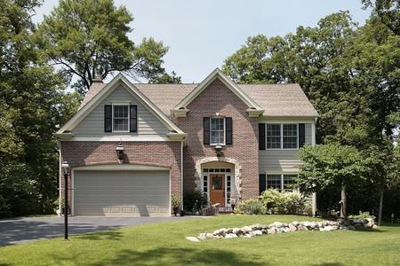 Brick home in suburbs with stone landscaping Stock Photo - 6760945