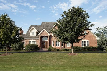 Luxury brick home in suburbs with circular driveway Stock Photo - 6761095