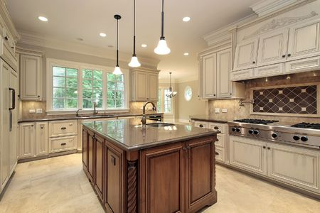 Kitchen with wood cabinets and marble counter photo
