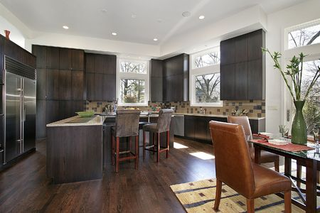 Modern kitchen with island and eating area photo