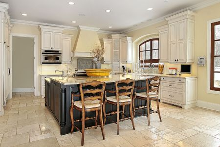 Kitchen in luxury home with walnut island photo