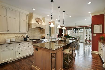 Kitchen in luxury home with marble island countertop Stock Photo