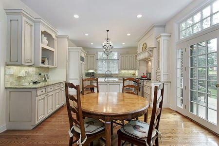 eating area: Kitchen in luxury home with island and eating area Stock Photo