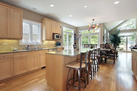 cabinetry: Large kitchen with oak cabinetry and marble island