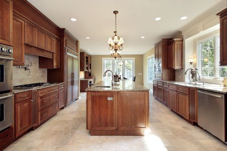 Kitchen in new construction house with wood and marble island photo