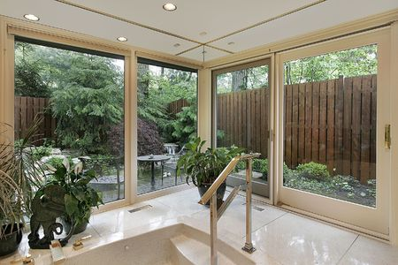 Master bath in luxury home with garden view photo