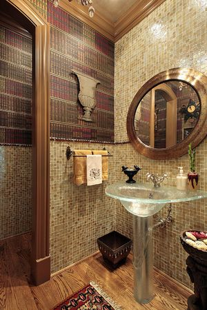 Powder room in luxury home with glass sink photo