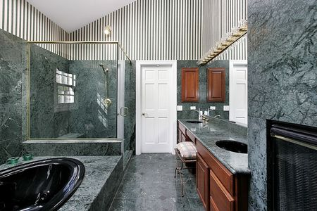 Luxury master bath with blue and green marble photo