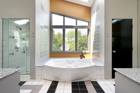 Modern upscale master bath with glass shower photo
