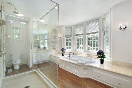 White master bath in new construction home with glass shower photo