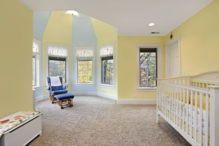 babys: Babys bedroom with yellow and blue walls