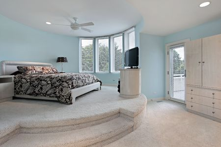 Bedroom in upscale home with step up sleeping area photo