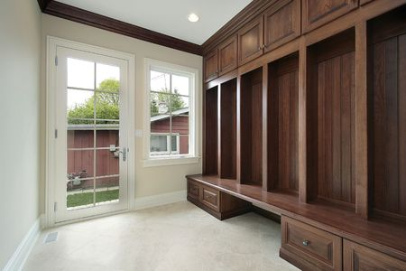 cabinetry: Mudroom in new construction home with wood cabinetry