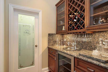 Butlers pantry with refrigerator in luxury home photo