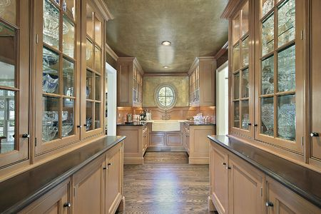 Pantry in luxury home with salmon colored cabinetry photo