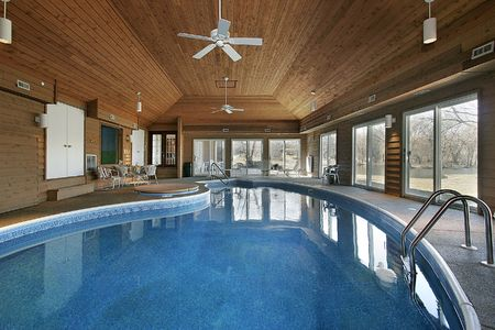 Large indoor swimming pool with wood ceiling photo