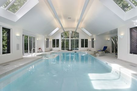 indoors: Large swimming pool in luxury home with skylights Stock Photo