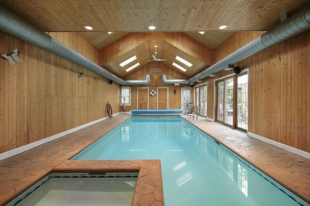 Large indoor swimming pool with wood siding photo