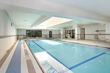 Swimming pool with swim lanes in condominium building photo