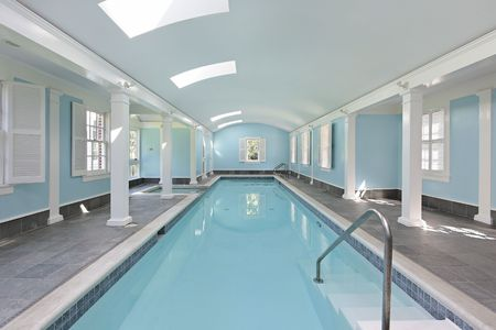 Long indoor swimming pool in luxury home photo