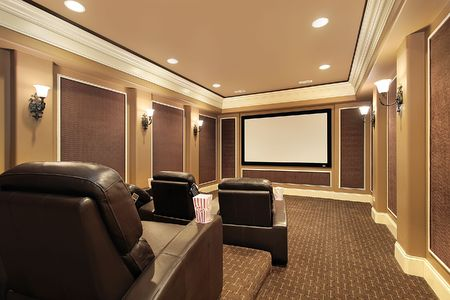 movie theatre: Home theater in luxury house with large TV screen Stock Photo