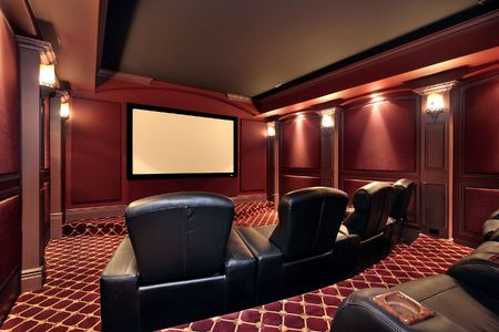 home furniture: Theater in luxury home with large leather chairs