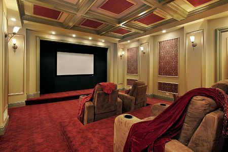 Theater in luxury home with plush red carpeting