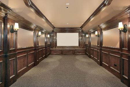 home furniture: Home theater in luxury home with wood paneled walls Stock Photo