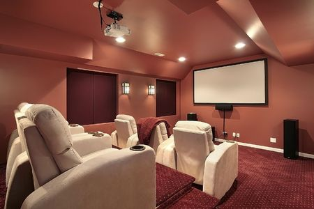Luxurious theater in upscale home with red walls photo