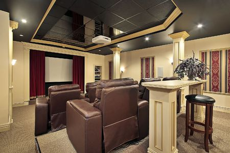 home theatre: Home theater in luxury home with columns Stock Photo