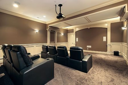 Theater in luxury home with stadium seating photo