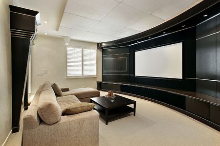 Theater room in luxury home with wide screen photo