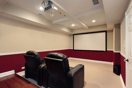 home furniture: Media room in luxury home with home theater chairs Stock Photo