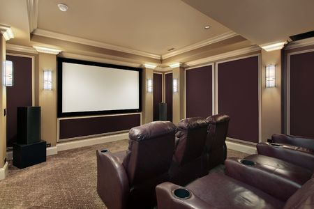 luxury home interior: Theater room in luxury home with lounge chairs Stock Photo