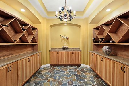 Wine cellar in luxury home with yellow walls photo