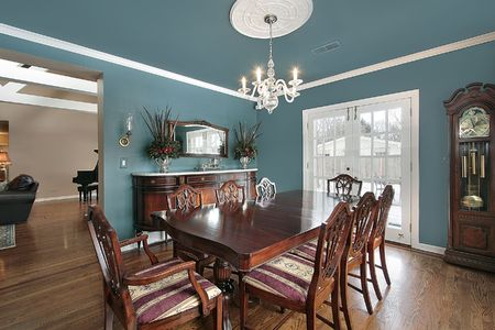 Elegant dining room with slate blue walls