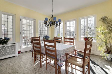 Eating area with windows and door leading to porch Stock Photo - 6760877