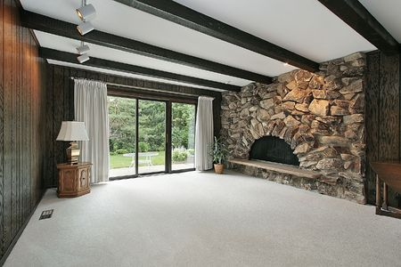 Family room with wood beams and stone fireplace