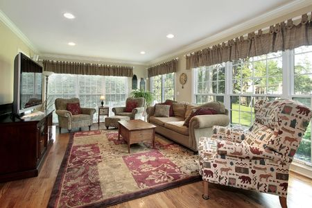 Sun room in luxury home with back yard view Stock Photo - 6733421