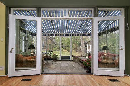 Entry to sun room with stone floor photo