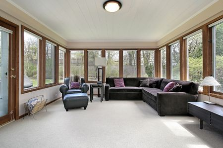 Family room in suburban home with wall of windows