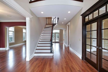 Foyer in new construction home with staircase Stock Photo