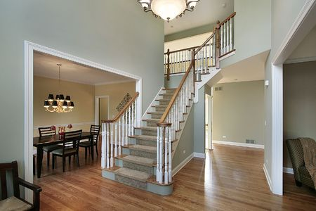 entryway: Foyer in luxury home with dining room view