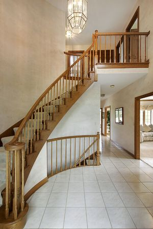 Foyer in luxury home with curved staircase Stock Photo - 6732911