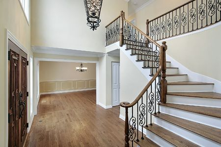 entryway: Foyer in new construction home with railing design