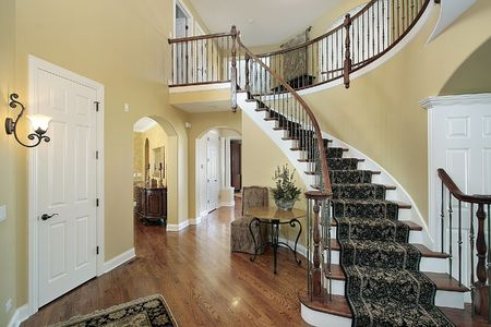 traditional living room: Foyer in luxury home with curved staircase