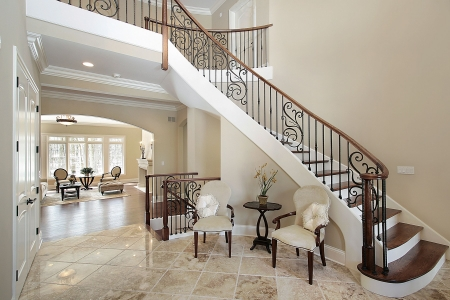 Foyer with curved staircase in luxury home photo